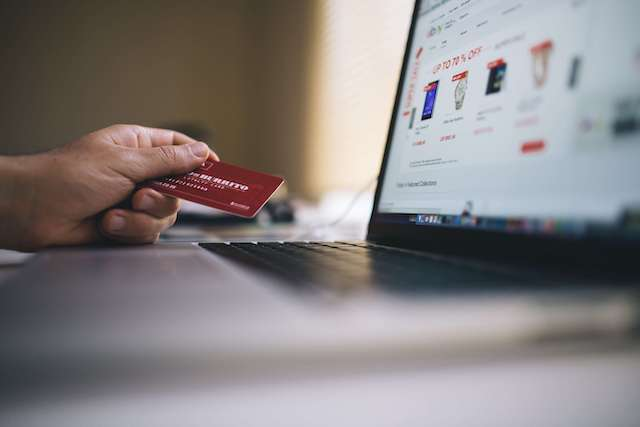 a web user entering bank card details to pay for a product online