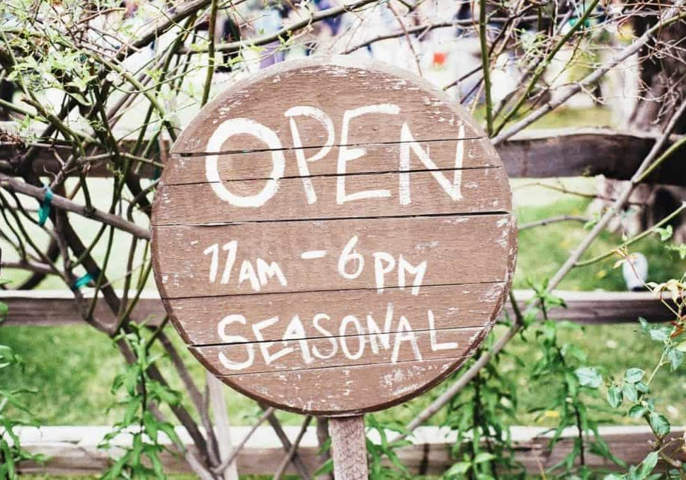 "Gate Sign Displaying ""Open 11am–6pm Seasonal"". Definitely a company in need of a local business website."